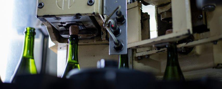 Wine bottles being corked