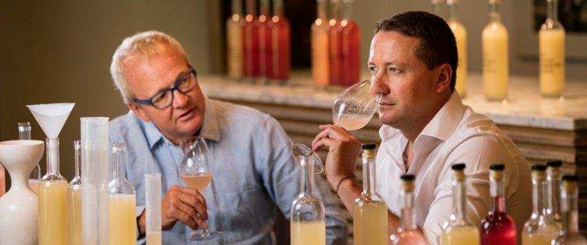 Two Winemakers tasting wine